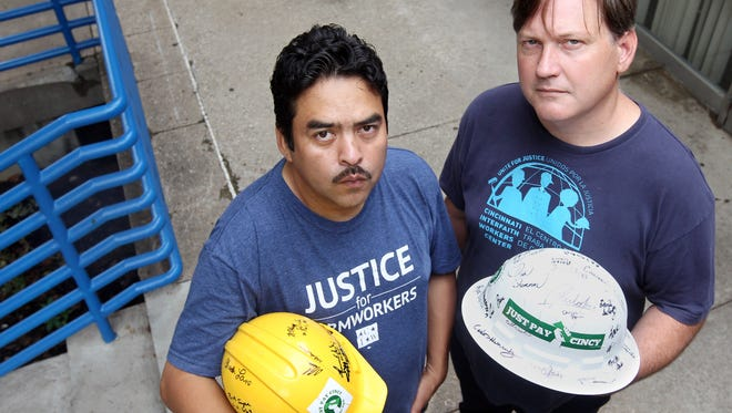 Brennan Grayron (right)' director of the Cincinnati Interfaith Workers Center and Manuel Perez, membership coordinator, outside the group's office in  Peaslee Neightborhoond Center Over the Rhine.The Enquirer/Patrick Reddy