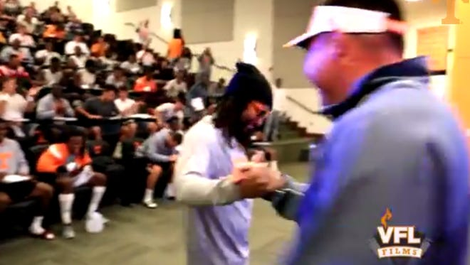 Rapper Lil Jon and Butch Jones shake hands upon meeting Sunday during a surprise visit.
