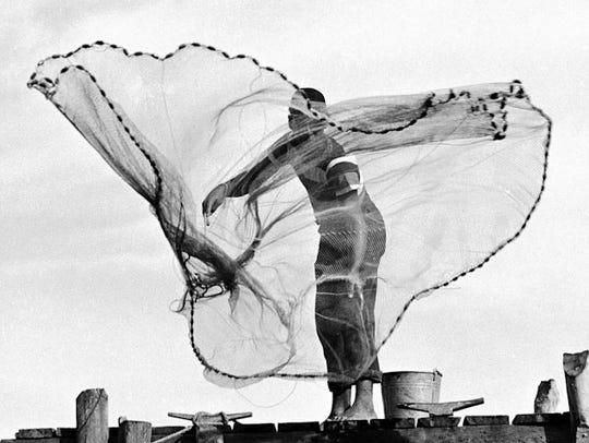 Esperanza Woodring casts for bait on Sanibel in 1948.