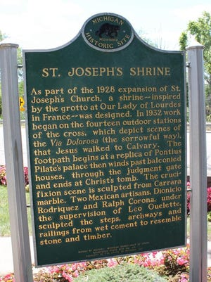 One of two historical markers, located at St Joseph's Church & Shrine in the Irish Hills, is pictured. The Michigan State Historic Preservation Office has placed similar historical markers on over 70 historic sites in Lenawee County.