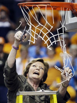 Tennessee head coach Pat Summitt cuts down the net after Tennessee defeated LSU 70-58 to win the NCAA college basketball championship game at the women's Southeastern Conference tournament on Sunday in Nashville. AP Photo Tennessee head coach Pat Summitt cuts down the net after Tennessee defeated LSU 70-58 to win the NCAA college basketball championship game at the women's Southeastern Conference tournament on Sunday, March 4, 2012, in Nashville, Tenn. (AP Photo/Mark Humphrey)