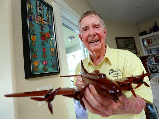 Stanton Rickey holds a model B-17 plane in front of