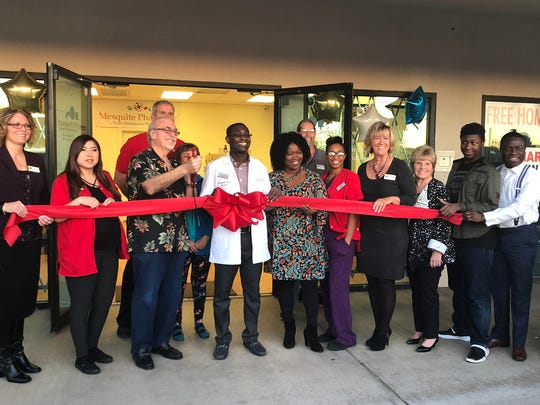 Dr. Emmanuel Kodjoe (center) poses with friends and family at the ribbon-cutting ceremony for his Mesquite Pharmacy on March 8, 2018.