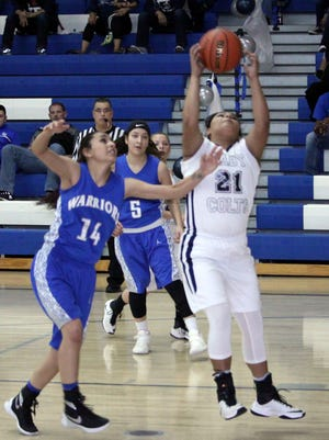 Aysia Salas grabs a carom during action against Socorro on Saturday. She had 11 points in the win for the Lady Colts.