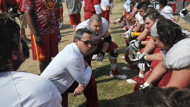 New offensive line coach Brandon Blaney works with his guys in the spring game