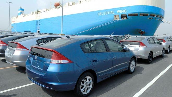 Honda Insight vehicles are parked to be loaded into a Honda cargo ship at a port in Yokkaichi, central Japan, February 2009.