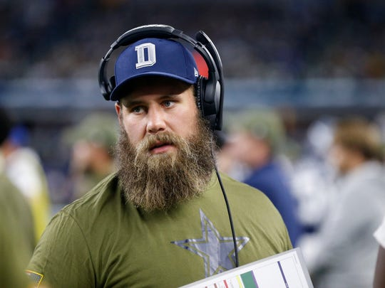 Dallas Cowboys lineman Travis Frederick walks the sidelines during the second half of an NFL football game against the Tennessee Titans, Monday, Nov. 5, 2018
