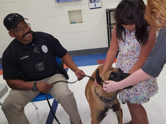 Joe Stanley Smith Elementary students meet Alf, one of the canine officers at the annual breakfast, Sept. 11, 2017. Alf is being handled by Carlsbad Police Officer Norman Bowie.