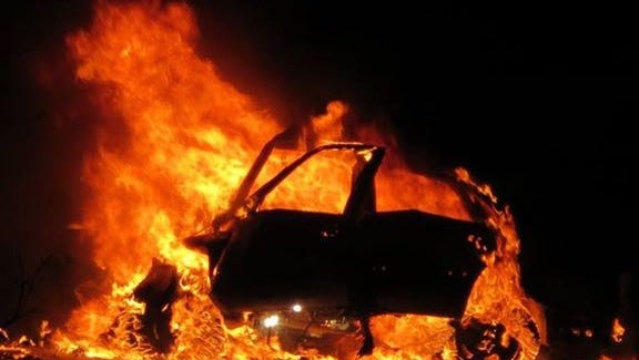 A Ford Taurus traveling the wrong way on Interstate 80 burst into flames after colliding with a Des Moines Police SUV carrying two officers and a prisoner. All four people in both vehicles were killed.