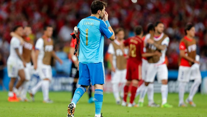 Spain's goalkeeper Iker Casillas walks off the pitch following his team's loss in the group B World Cup soccer match between Spain and Chile at the Maracana Stadium in Rio de Janeiro, Brazil, Wednesday, June 18, 2014. Defending champion Spain was eliminated from the World Cup after losing to Chile 2-0.