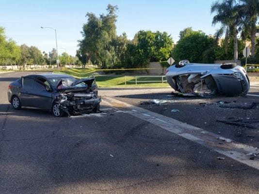 Collision injures two, closes roadway