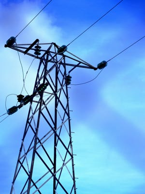 A file photo showing a low angle view of high tension wires across a pole. A power outage left about 1,628 NVEnergy customers without electricity in Reno.