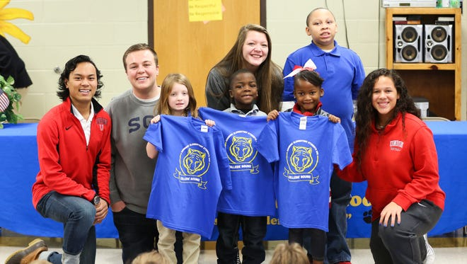 Union University students donate T-shirts to Denmark Elementary School.