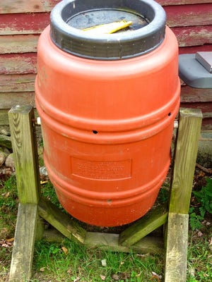 Compost bin made out of a barrel.