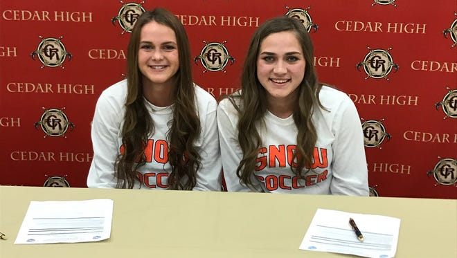 Sisters Rachel Hunt and Julia Hunt of Cedar High School signed with Snow College on Feb. 22, 2018.
