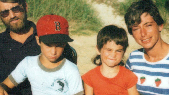 Detroit Tigers manager Brad Ausmus, second from left in this childhood photo, sits with his father, Harry, sister Laura and mother Linda, who died after a cancer battle last year.
