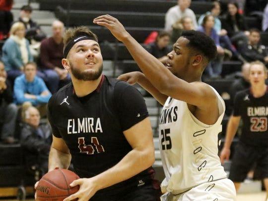 Dan Fedor of Elmira looks for a shot as Myles Bankston