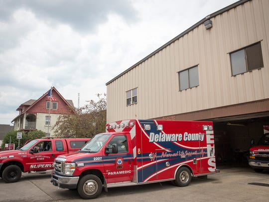 Delaware County EMS sit in front of the EMS garage in downtown Muncie. Mayor Dennis Tyler is considering creating a city-based ambulance service, which would take over duties normally done by the Delaware County EMS.