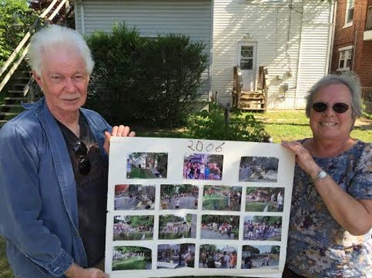 Tom and Dianne Boyle, landlords of three properties on West Jackson Street, hold a collage of photos Thursday showing when the houses would get together for a pig roast several years ago. This weekend, York City Police busted a party there. A student who organized it had a permit from the city's Public Works Department.