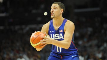 USA guard Klay Thompson (11) shoots a basket against China in the first half during an exhibition basketball game at Staples Center.