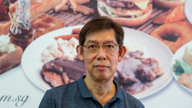Patrick Soh, who introduced the first fast-food franchise to North Korea, at his Waffletown USA restaurant in Singapore.