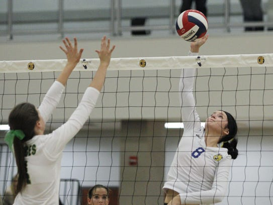 Exeter's Alexis Kirkman looks to spike one against
