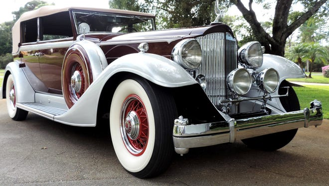 Ed Miller's maroon and silver 1933 Packard is one of only four in existence today.