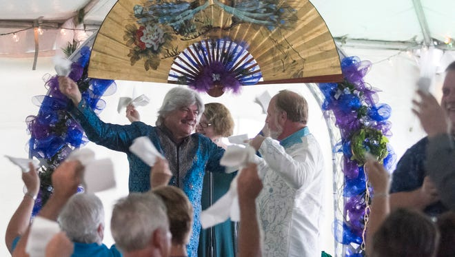 """Ron Kopko and Mark Solomon dance to """"Love is in the Air,"""" on after exchanging their vows on Saturday, July 4, 2015, after 18 years together. The couple used to own The Bar Association in downtown Fort Myers and used to play the song often. They and the patrons would throw napkins into the air, so they wanted to do the same thing at their wedding."""