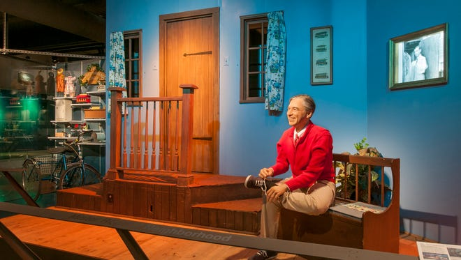 "This image provided by the Senator John Heinz History Center in Pittsburgh shows a set from the old PBS children's television show ""Mister Rogers' Neighborhood,"" including a model of host Fred Rogers tying his trademark sneakers as he did at the start of every episode. The Heinz History Center is part of the Fred Rogers Trail being promoted by Pennsylvania tourism officials on the 50th anniversary of the show's 1968 launch. A new documentary called ""Won't You Be My Neighbor?"" has also rekindled interest in Rogers' legacy. (Senator John Heinz History Center via AP)"