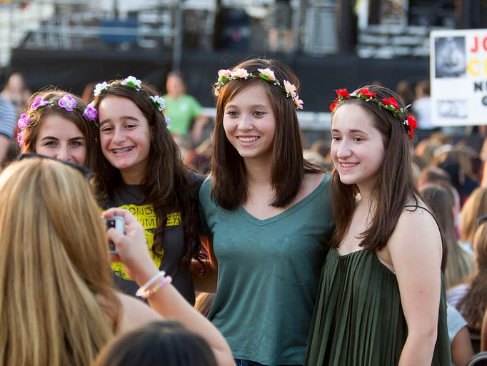 """Fans take photos before Hey Violet, the opening act"
