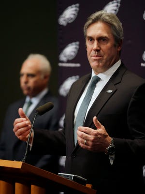 Philadelphia owner Jeffrey Lurie, left, listens as Doug Pederson, right, answers a question after he was introduced as the head coach of the Eagles on Tuesday.