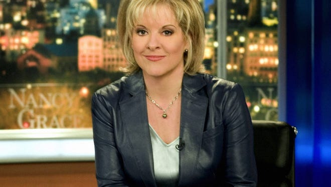 This undated promotional photo provided by CNN Headline News, shows Nancy Grace on the Headline News set in New York.