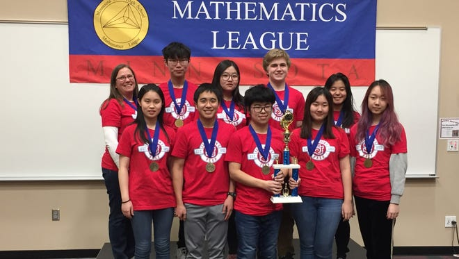 St. John's Preparatory School students, pictured with coach and math teacher Mary Rueter at left, earned first-place in their class at the Minnesota State High School Mathematics League competition March 12.