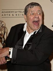 Comedian Jerry Lewis poses backstage after being honored