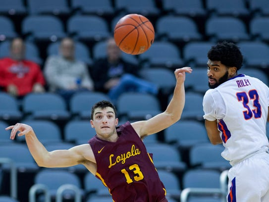 Loyola Chicago's Clayton Custer (13) makes a pass by