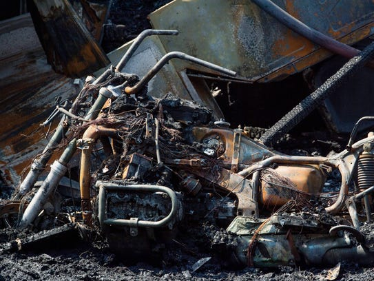 A motorcycle, one of six, sits in the rubble of Feller's