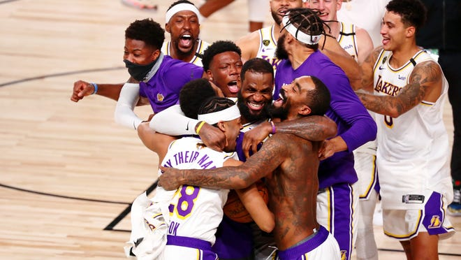 The Los Angeles Lakers celebrate their 106-93 win over the Miami Heat after Game 6 of the 2020 NBA Finals in Lake Buena Vista, Florida, on Sunday night.