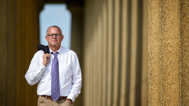 Dr. Stephen Loyd, then assistant commissioner for Tennessee Substance Abuse Services division. poses for a portrait at the Parthenon in Centennial Park  in Nashville, Tenn., Wednesday, Aug. 30, 2017.