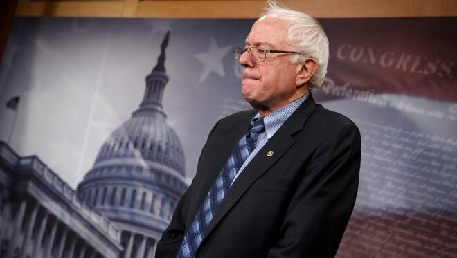 This Feb. 20, 2014, file photo shows Senate Veterans Affairs Committee Chairman Sen. Bernie Sanders, I-Vt., standing in defeat after a divided Senate derailed Democratic legislation providing $21 billion for medical, education and job-training benefits for the nation's veterans, as the bill fell victim to election-year disputes over spending and whether to slap sanctions on Iran on Capitol Hill in Washingtons. (AP Photo/J. Scott Applewhite)