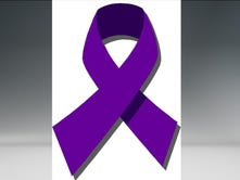 A purple ribbon, which symbolized Domestic Violence Awareness Month.