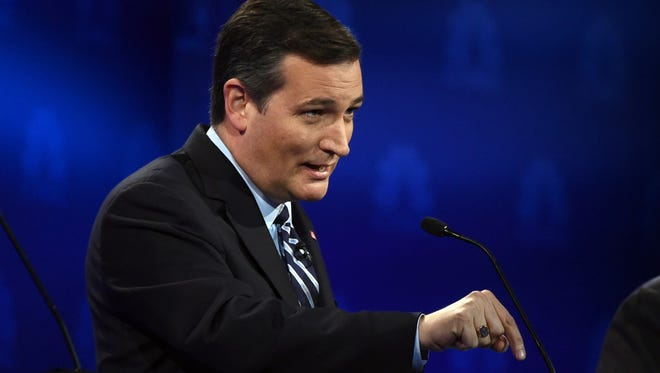 Republican Presidential hopeful Ted Cruz gestures during the CNBC Republican Presidential Debate, October 28, 2015 at the Coors Event Center at the University of Colorado in Boulder, Colorado.