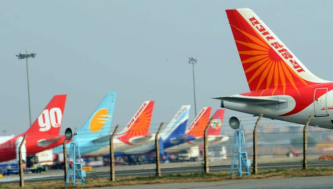 This file photo from June 24, 2010, shows the tail of an Air India Airbus A320 aircraft (right) on the tarmac of the Indira Gandhi International Airport in New Delhi.