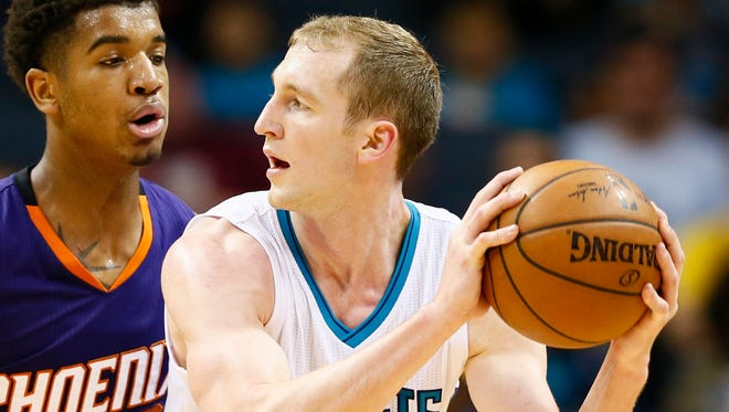 Charlotte Hornets center Cody Zeller (40) looks to pass the ball against Phoenix Suns forward Marquese Chriss (0) in the second half at Spectrum Center.