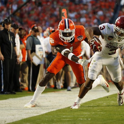 Dec 31, 2015; Miami Gardens, FL, USA; Oklahoma Sooners running back Samaje Perine (32) scores a touchdown against the Clemson Tigers in front of former Immokalee star Mackensie Alexander (2) during the first half of the 2015 CFP semifinal at the Orange Bowl at Sun Life Stadium. Mandatory Credit: Robert Duyos-USA TODAY Sports