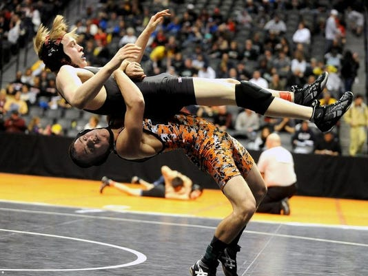 Rocky Mountain High School's Logan Newman is taken down by Lakewood High School's Austin Harp during a consolation round on