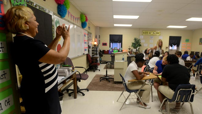 Jackson-Madison County schools Superintendent Verna Ruffin, left, visits a class at West Middle School on Monday, the first day of school.