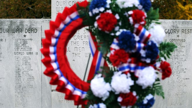 A wreath sits near the War Memorial Monument after the Veterans Day Celebration in 2014.