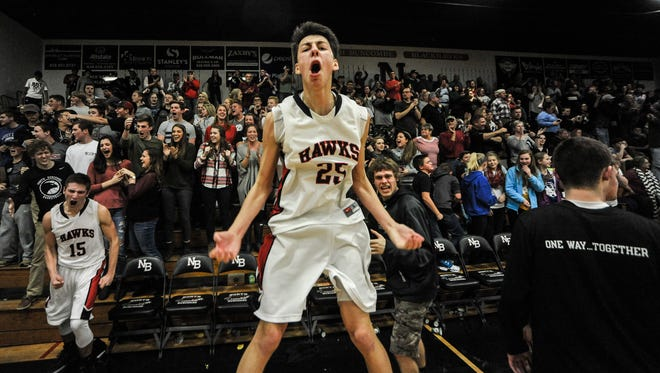 North Buncombe's Christian Powell (25) celebrates after Friday's 74-73 home win over Asheville High.