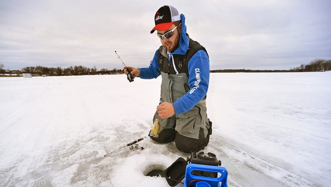 Grant Hopke, St. Augusta, does some practice fishing Wednesday, Jan 27 on Beaver Lake near Luxemburg. Hopke and his partner Keenan Hemming are competing in the North American Ice Fishing Circuit tournament in February on Lake Mille Lacs.