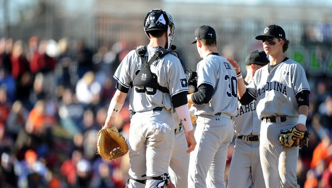 South Carolina pitcher Braden Webb (30) is pulled from the mound during the Reedy River Rivalry game against Clemson University at Fluor Field in Greenville on Saturday.